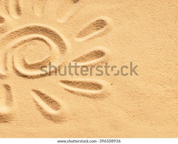 sand sun print on a beach in a summer sunset