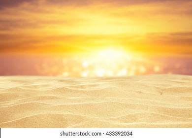 sand and sunset of golden hour time and water of ocean