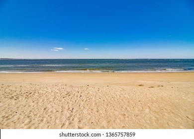 Sand, sunshine, and blue skies, a perfect combination for any beach lover. Ocean View beach in Norfolk, Virginia.
