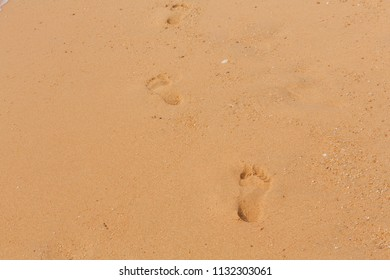 Sand texture with foot prints on the beach. Copy space
