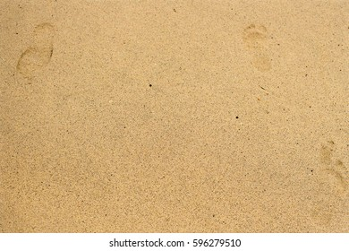 Sand texture with footprints