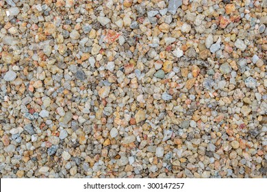 sand texture and stone pieces