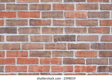 A sand textured brick wall