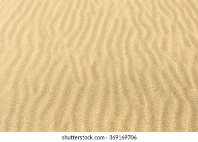 Sand texture.Dented wave of the blow of the wind.