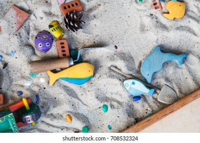 sand therapy. the child playing with toy the sand. the psychologist works