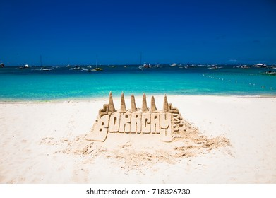 Sand tower castle at White beach of Boracay island . Philippines.