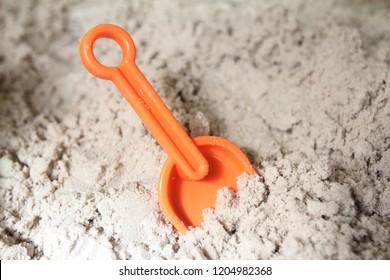 Sand toys in a sandbox