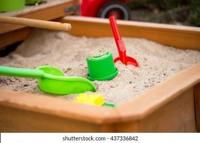 Sand toys in a sandbox / Sand toys