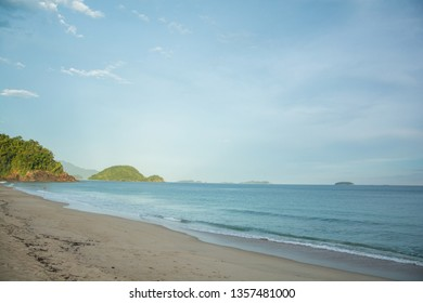 sand and waves with florest background of beach of felix in ubatuba, brazil
