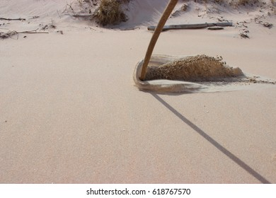Sand waves as a result of dragging a stick along the ground. Stop motion of shock wave.