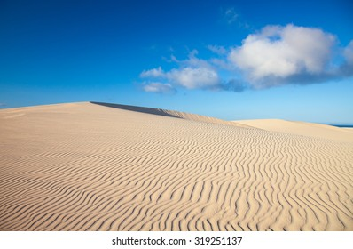 sand and wind pattern on dune surface natural background