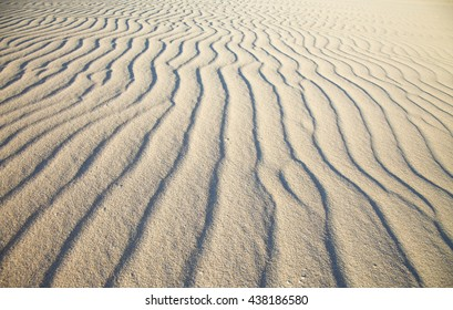 sand and wind pattern on dune surface