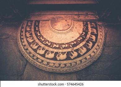 Sandakada pahana or Moon-stone at the entrance to the Polonnaruwa Vatadage, Polonnaruwa, Sri Lanka