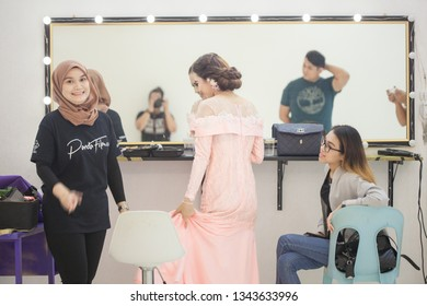 Sandakan Sabah 17 march 2019 Professional make up artist and hair just finish make up her talent for photoshoot season at panda film studio .