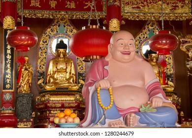 SANDAKAN, SABAH - JAN 10, 2019: Buddha Statues Inside Puu Jih Shih Buddhist Temple. A Popular Sacred & Religious Sites In Sandakan