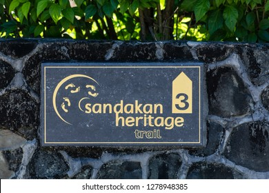 """Sandakan, Sabah, Malaysia - April 28 2016: Marker of the """"Heritage Trail Sandakan"""", a tourist path to the most important historic attractions"""