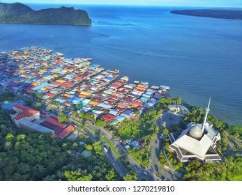 Sandakan Sabah Malaysia - Dec 28, 2018 : Sky view of Sandakan City with Sandakan District Mosque, Kg. Sim Sim water village and Berhala Island.