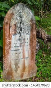 Sandakan, Sabah, Malaysia - February 10 2013: Historical Christian Cemetery Sandakan (founded 1883) in Sandakan, Sabah, Malaysia. Tombstone of Second-Engineer Adolph Reppich, drowned 17 May 1909