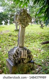 Sandakan, Sabah, Malaysia - February 10 2013: Historical Christian Cemetery Sandakan (founded 1883) in Sandakan, Sabah, Malaysia. Tombstone of Susam Mary Marcus, died 9 July 1905.