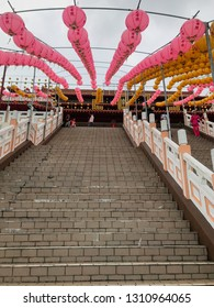 Sandakan, Sabah, Malaysia - Febuary 06, 2019 : The outside of Puu Jih Shih Temple with decorations for Chinese New Year in the background
