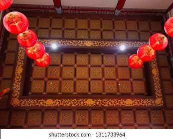 Sandakan, Sabah, Malaysia - Febuary 06, 2019 : An interiors of Puu Jih Shih ceiling Temple with decorations for Chinese New Year in the background
