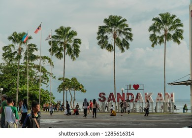 """Sandakan, Sabah, Malaysia - JANUARY 13, 2019 : """"I Love Sandakan"""" signage in Harbour Square with crowded people visits in Sandakan city centre."""