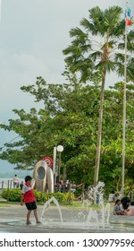 Sandakan, Sabah, Malaysia - January 13,2018 : Street view of kids playing in the water dancing at Sandakan town in the afternoon.