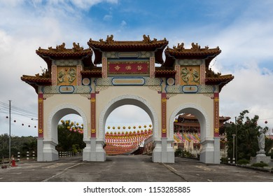 Sandakan, Sabah, Malaysia - January 2 2014: Gate of Puu Jih Shih Temple with decorations for Chinese New Year in the background