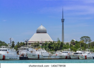 Sandakan, Sabah, Malaysia - March 26 2016: The famous Sandakan District Mosque also known as Masjid Besar Sim-Sim, viewed from the waters of Maritim Malaysia Sandakan branch
