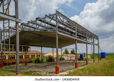 Sandakan, Sabah, Malaysia - March 26 2016: The open hall for a school and the village empowered by solar panels on the roof at an island in Sandakan