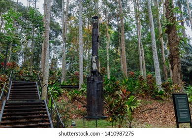 """Sandakan, Sabah, Malaysia - March 29 2016: The remains of a steam boiler in Sandakan Memorial Park, the former POW Camp which is infamous for the so called """"Sandakan Death March"""""""