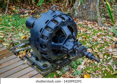 """Sandakan, Sabah, Malaysia - March 29 2016: The remains of an alternator for power generation in Sandakan Memorial Park, the former POW Camp which is infamous for the so called """"Sandakan Death March"""""""