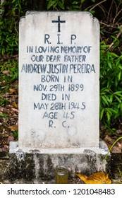Sandakan, Sabah, Malaysia - March 3 2018: Tombstone of A. J. Pereira (1899-1945) on the historical Christian Cemetery Sandakan (founded 1883)