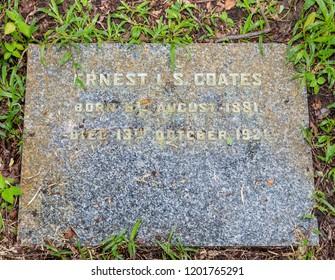 Sandakan, Sabah, Malaysia - March 3 2018: Tombstone of Ernest I. S. Coates (1881-1921) on the historical Christian Cemetery Sandakan (founded 1883)