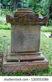 Sandakan, Sabah, Malaysia - March 3 2018: 19th century tombstone of the engineer Edgar Foreman (1860 - 1897) on the historical Christian Cemetery Sandakan (founded 1883)
