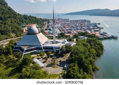 Sandakan Sabah Malaysia - May 15, 2018 : Partial view of Sandakan City with Sandakan District Mosque and Kg. Sim Sim water village. Sandakan once known as Little Hong Kong of Borneo.