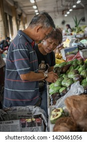 Sandakan, Sabah, Malaysia - May 22, 2019 : Vendors at rural market in Sandakan Local Fresh Market. In Sabah, Sandakan is a ranks first in economic freedom, ease of doing business, and peace.
