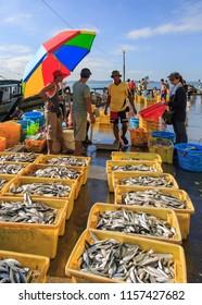Sandakan, Sabah, Malaysia - May 27 2014: Fishmarket in Sandakan Harbour; Fishmarket in Sandakan Harbour; a dealer is negotiating with the fishermen