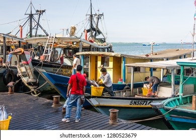 Sandakan, Sabah, Malaysia - May 27 2014: In the early morning, the fishing flotilla returns to the town, unloading the catch of the night at the Sandakan Fish Market