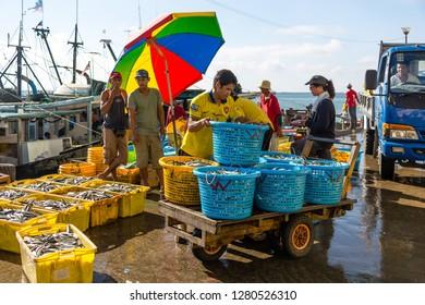 Sandakan, Sabah, Malaysia - May 27 2014: Local businessmen negotiating with the fishermen at quay in front of the Sandakan Fish Market