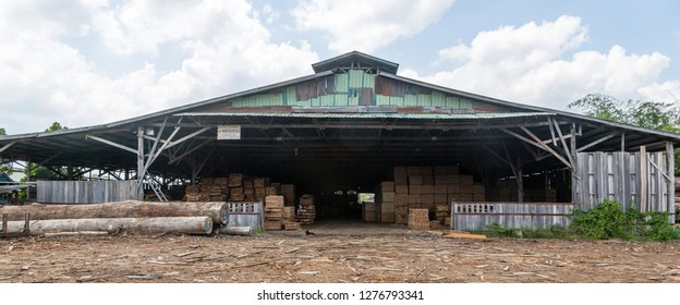 Sandakan, Sabah - March 28 2016: In-feed point and storage for sawn timber of a sawmill at Seguntor Industrial Area