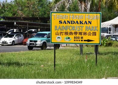 SANDAKAN, SABAH - May 12, 2018 : a signage of the Sandakan Rainforest Park at Mile 5, North Road Sandakan. Text in Photo meaning to show way to Sandakan Rainforest Park. Sabah.