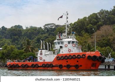 """Sandakan, Sabah - May 26 2016: Tug """"JPD DUA"""" of Sabah Ports and Harbours Department (malay: Jabatan Pelabuhan dan Dermaga Sabah) mooring in Sandakan Harbour"""