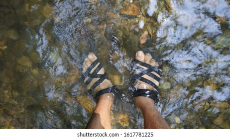 The sandal made from used car wheel rubber, seeing through clear waterfall flow