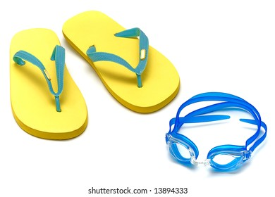 sandals and glasses for swimming on the white