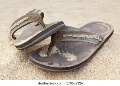 sandals on the beach.