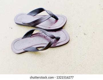 Sandals on the sand beach