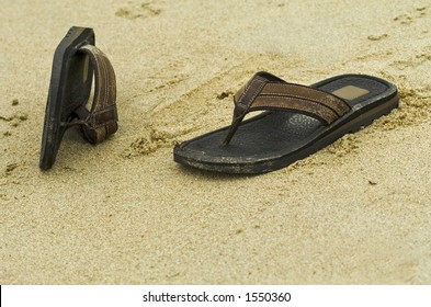 Sandals on a sandy beach