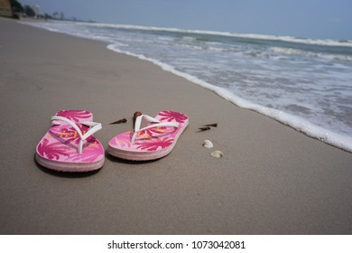 a25f466ac899 Sandals in the sea. Sandals in the sea. women s shoes on the sand