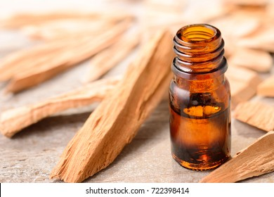 Sandalwood essential oil on the wooden board